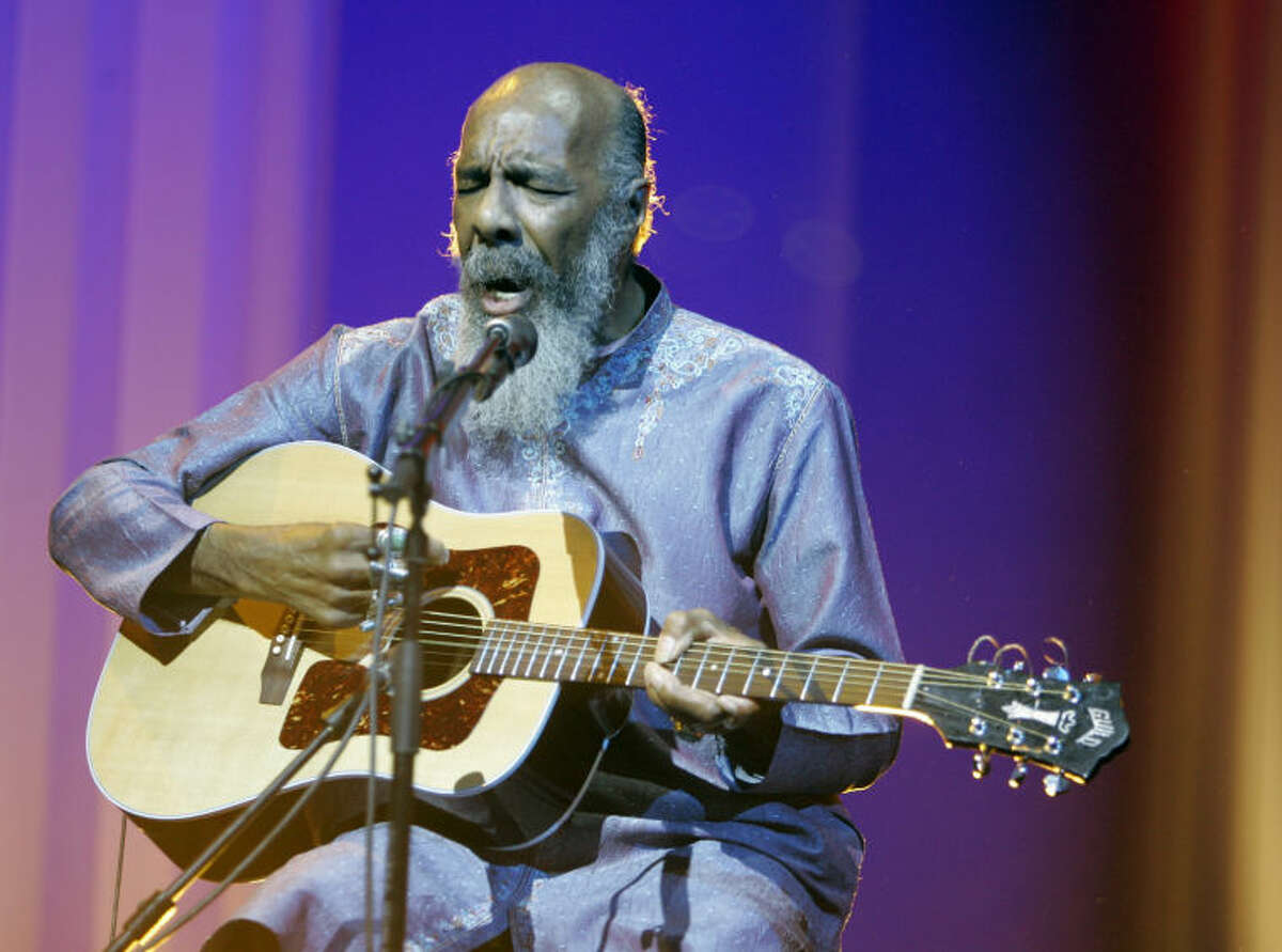 FILE - In this May 1, 2008 file photo, Richie Havens plays at the opening night ceremony during the 61st International film festival in Cannes, southern France. Havens, who sang and strummed for a sea of people at Woodstock, has died at 72. His family says in a statement that Havens died Monday, April 22, 2013, of a heart attack. (AP Photo/Jeff Christensen, file)
