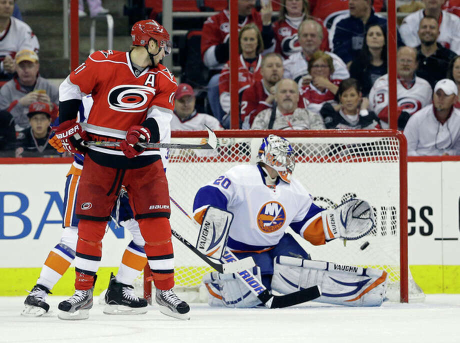 New York Islanders goalie Evgeni Nabokov (20) of Kazakhstan, watches a goal by Carolina Hurricanes' Jordan Staal (11) during the first period of an NHL hockey game in Raleigh, N.C., Tuesday, April 23, 2013. (AP Photo/Gerry Broome) / AP