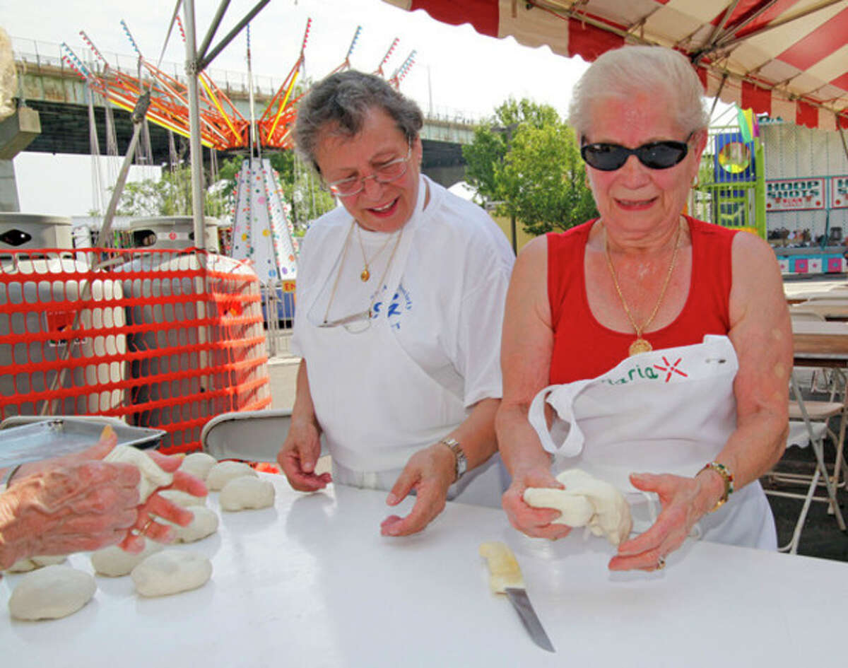 Hour Photo / Danielle Robinson At top, Dylan Ehlers 10, heads the St. Ann's Club feast procession at last year's event. Above, Ada Ruggiero and Maria Santorella prepare dough for pizza fritta during last year's St. Ann's Festival.