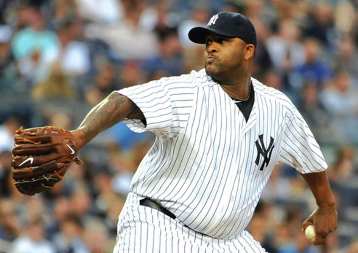 AP photo New York Yankees starting pitcher CC Sabathia throws to the Seattle Mariners in the first inning of Tuesday night?•s game. Sabathia worked into the eighth inning of the Yankees?• 4-1 victory.