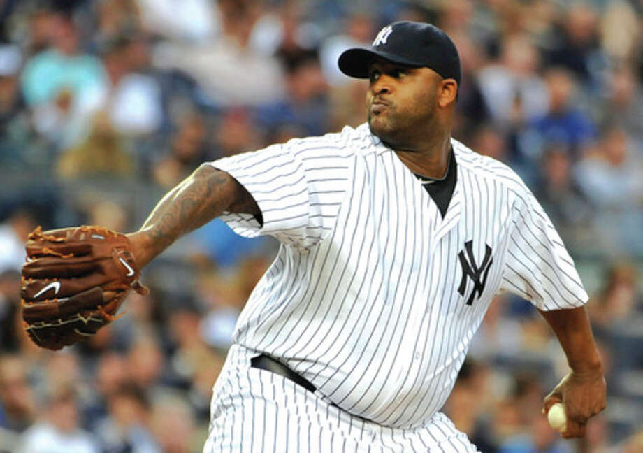 AP photo New York Yankees starting pitcher CC Sabathia throws to the Seattle Mariners in the first inning of Tuesday nightÕs game. Sabathia worked into the eighth inning of the YankeesÕ 4-1 victory. / FR170189 AP