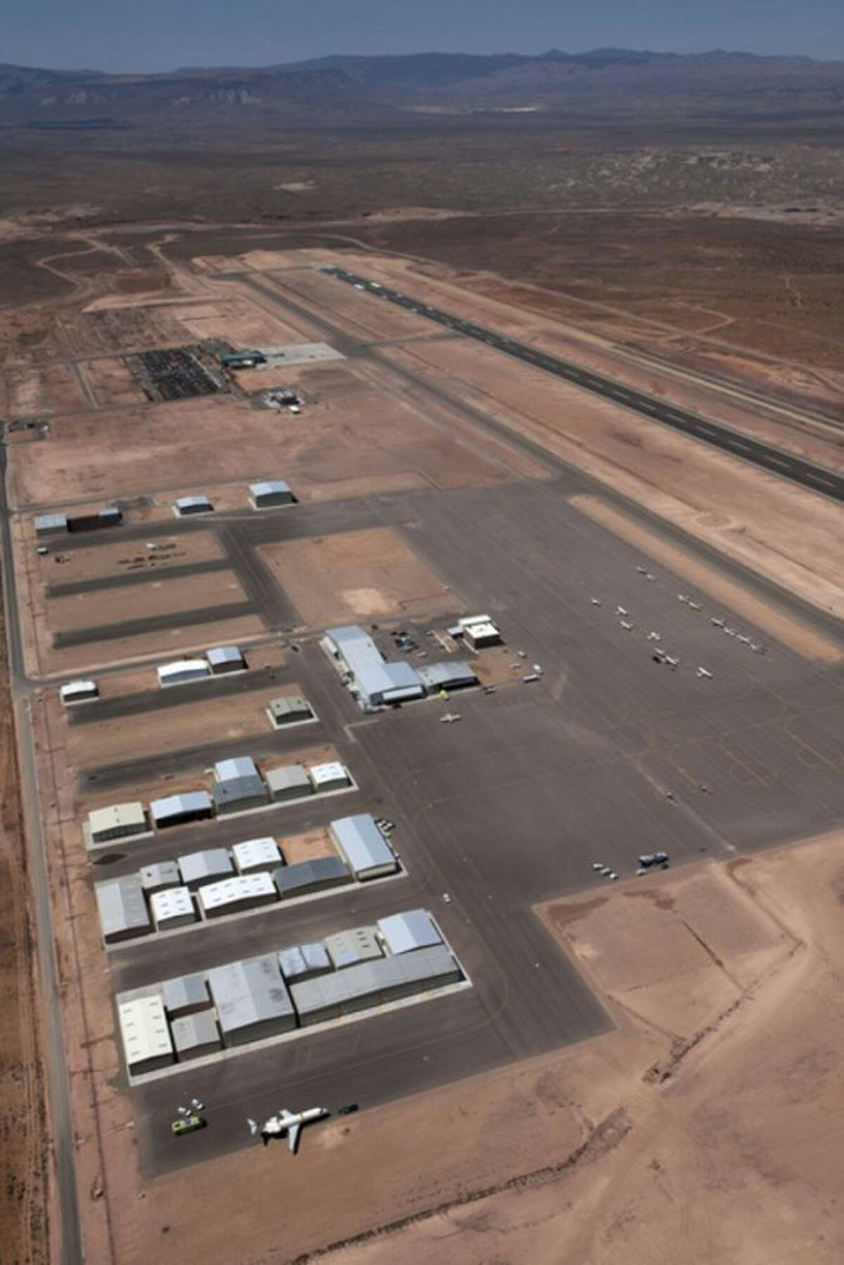 An aerial view shows the St. George Municipal Airport Tuesday, July 17, 2012. A SkyWest Airlines employee wanted in a murder case attempted to steal a passenger plane, then shot himself in the head after crashing the aircraft in a nearby parking lot, officials said Tuesday. Brian Hedglin, 40, scaled a razor wire fence at the St. George Municipal Airport early Tuesday, then boarded the 50-passenger SkyWest jet while the airport was closed, St. George city spokesman Marc Mortenson said. (AP Photo/The Spectrum, Jud Burkett) NO SALES