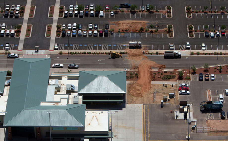 An aerial view shows the St. George Municipal Airport Tuesday, July 17, 2012. A SkyWest Airlines employee wanted in a murder case attempted to steal a passenger plane, then shot himself in the head after crashing the aircraft in a nearby parking lot, officials said Tuesday. Brian Hedglin, 40, scaled a razor wire fence at the St. George Municipal Airport early Tuesday, then boarded the 50-passenger SkyWest jet while the airport was closed, St. George city spokesman Marc Mortenson said. (AP Photo/The Spectrum, Jud Burkett) NO SALES / The Spectrum