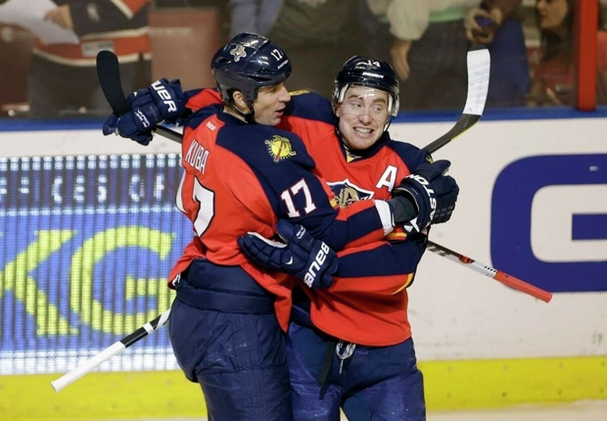 Florida Panthers' Tomas Fleischmann (14) celebrates with Filip Kuba (17) after he scored against the New York Rangers during the second period of an NHL hockey game in Sunrise, Fla., Tuesday, April 23, 2013. (AP Photo/J Pat Carter)