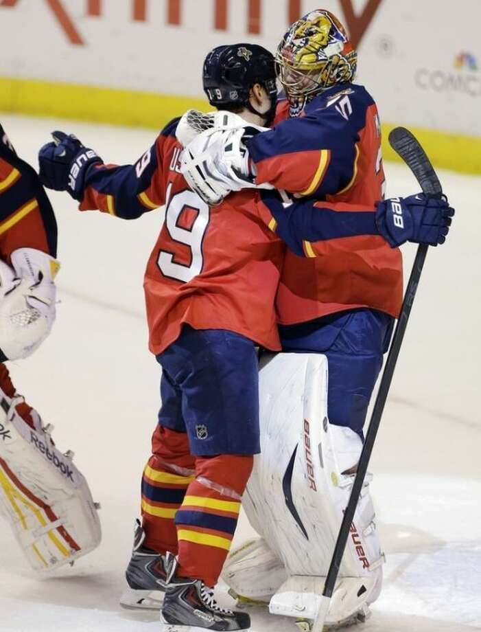 Florida Panthers' Scottie Upshall (19) and goalie Jacob Markstrom (35) celebrate after defeating the New York Rangers 3-2 in an NHL hockey game in Sunrise, Fla., Tuesday, April 23, 2013. (AP Photo/J Pat Carter)