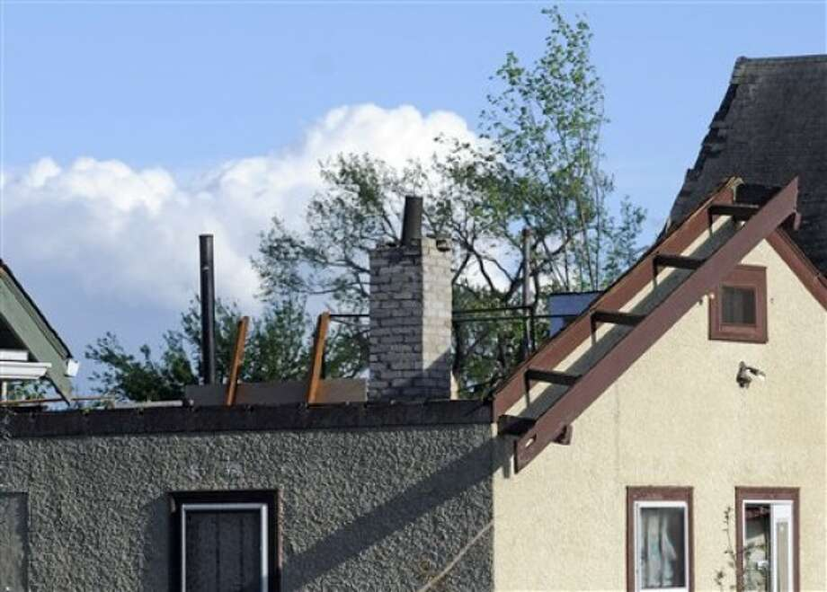 A house stands without a roof after a tornado struck northern Minneapolis, Sunday, May 22, 2011, causing extensive property damage, killing at least one person and injuring at least 18 others. (AP Photo/Craig Lassig)