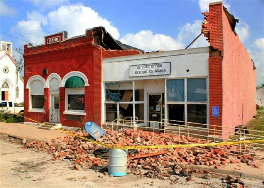 The Reading post office stands damaged in Reading, Kan., Monday, May 23, 2011. Utility crews worked Monday to restore power to the town of about 250 residents after it was struck over the weekend by a tornado with estimated winds of up to 165 mph. The storm claimed one life and caused extensive damage. (AP Photo/ Emporia Gazette, Matthew Fowler)