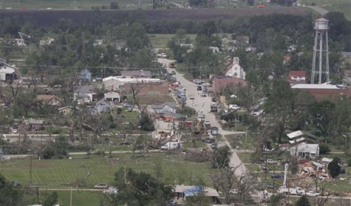 Power line repair and tornado clean up are viewed from the helicopter of Gov. Sam Brownback during a tour of Reading, Kan., Monday, May 23, 2011. (AP Photo/Orlin Wagner)