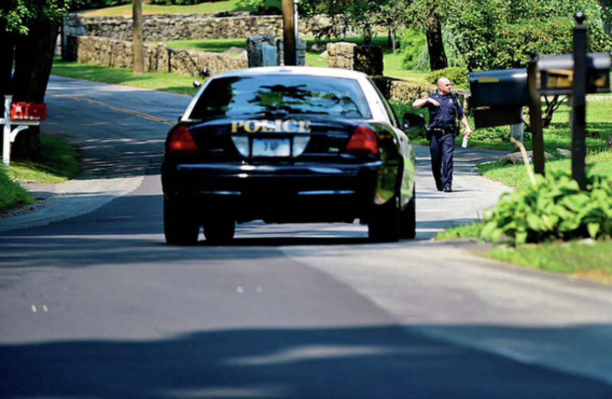 Westport and State Police investigate a larceny on Hillandale Rd in Westport Wednesday morning. Hour photo / Erik Trautmann