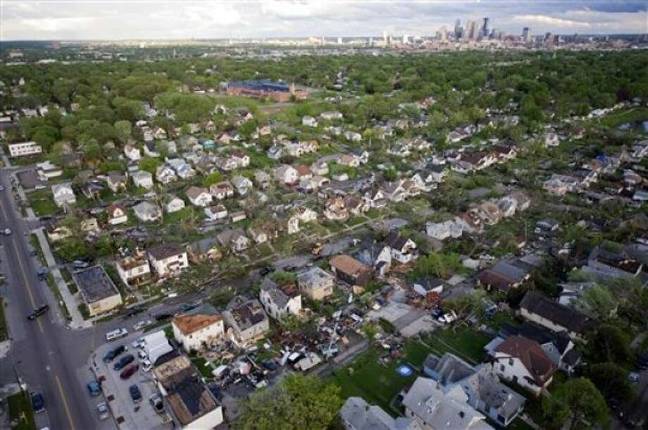 This aerial view shows tornado damage to residences in north Minneapolis, Sunday, May 22, 2011. At least one person died when the tornado barreled through the residential portion of Minneapolis on Sunday, damaging at least 100 homes, toppling hundreds of trees and injuring at least 29 people. (AP Photo/The Star Tribune, David Brewster)