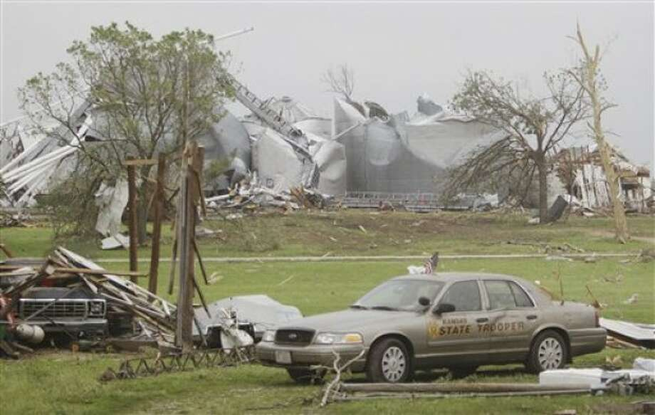 A Kansas state trooper''s vehicle sits among other tornado-damaged property in Reading, Kan., Monday, May 23, 2011. The trooper lived in the town and was home when the tornado moved through Saturday evening. About 200 homes were damaged in and around Reading, a town of about 250 residents. (AP Photo/Orlin Wagner)
