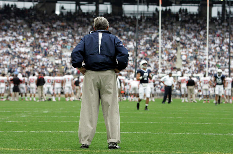 "FILE - In this Sept. 6, 2008 file photo, Penn State coach Joe Paterno surveys the field before an NCAA college football game against Oregon State at Beaver Stadium in State College, Pa. NCAA president Mark Emmert says he isn't ruling out the possibility of shutting down the Penn State football program in the wake of the Jerry Sandusky child sex abuse scandal. In a PBS interview Monday night, July 16, 2012, he said he doesn't want to ""take anything off the table"" if the NCAA determines penalties against Penn State are warranted. (AP Photo/Carolyn Kaster, File) / AP"