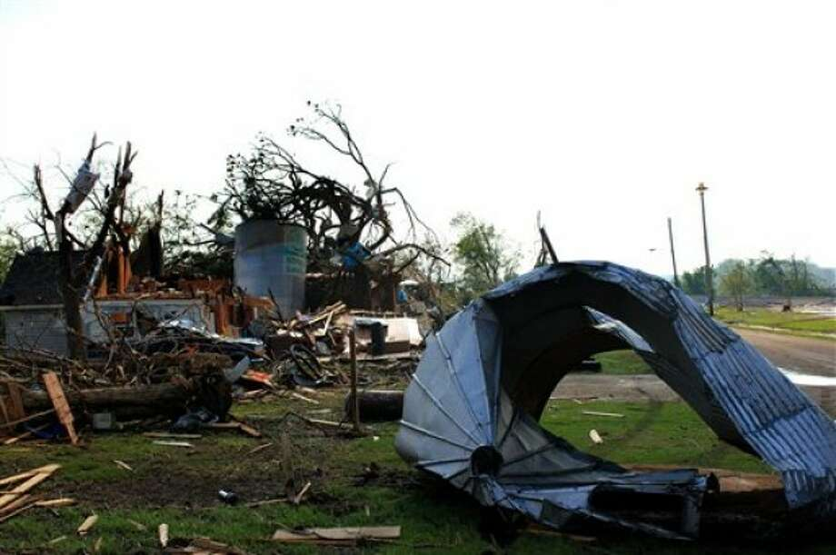 A house stands damaged in Reading, Kan., Monday, May 23, 2011. Utility crews worked Monday to restore power to the town of about 250 residents after it was struck over the weekend by a tornado with estimated winds of up to 165 mph. The storm claimed one life and caused extensive damage. (AP Photo/ Emporia Gazette, Matthew Fowler)
