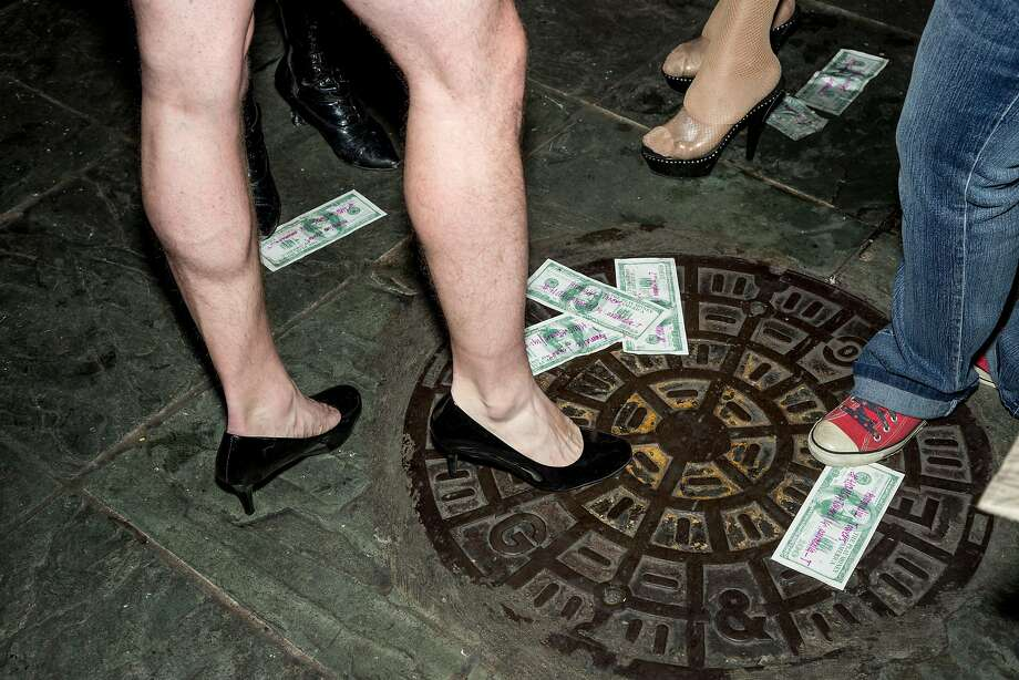 Fake money on the floor after the Daughter showcase at the Oasis, in San Francisco. Photo: Jason Henry, Special To The Chronicle