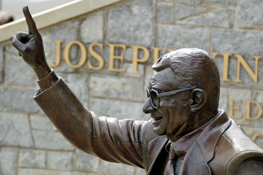 The statue of former Penn State University head football coach Joe Paterno stands outside Beaver Stadium in State College, Pa., Friday, July 13, 2012. After an eight-month inquiry, former FBI director Louis Freeh's firm produced a 267-page report that concluded that Paterno and other top Penn State officials hushed up child sex abuse allegations against former Penn State assistant football coach Jerry Sandusky for more than a decade for fear of bad publicity, allowing Sandusky to prey on other youngsters. The revelations contained in the report have stirred a debate over whether the statue should remain. (AP Photo/Gene J. Puskar) / AP