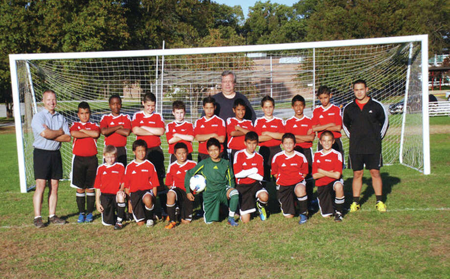 Contributed photo The Norwalk Community Soccer Club's U-13 boys team scored two wins and a tie over the weekend to conclude an unbeaten fall campaign. They are the South-West District champs.