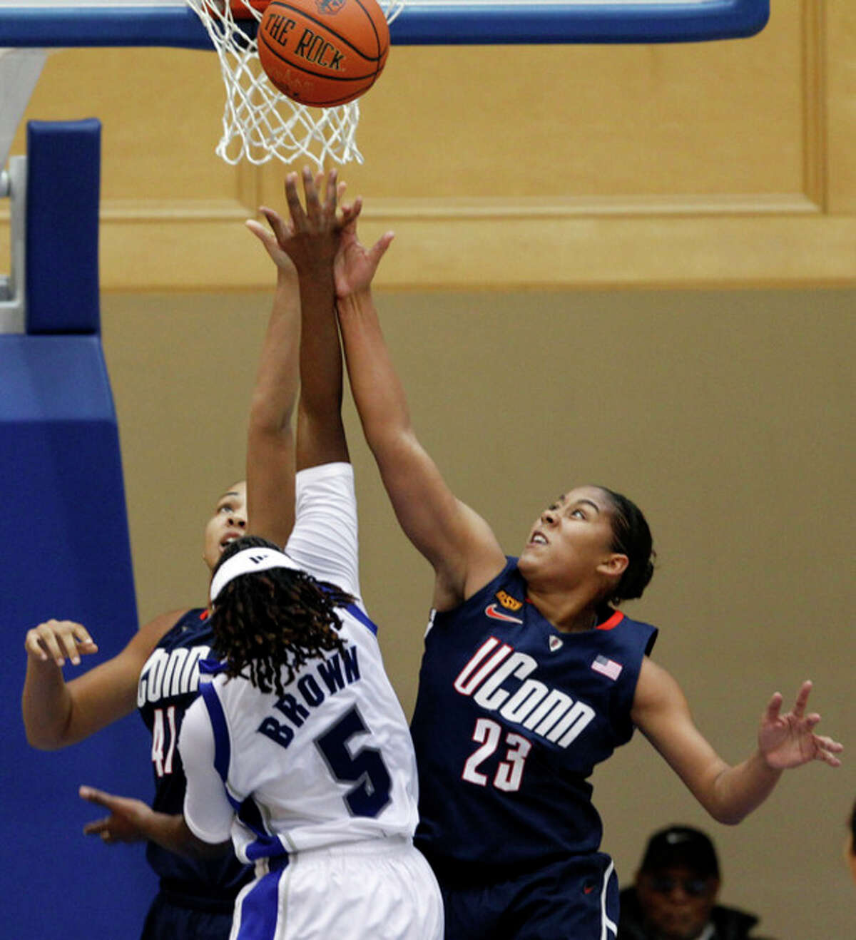 Connecticut's Kiah Stokes (41) and Kaleena Mosqueda-Lewis (23) block a shot by Seton Hall's Alexis Brown (5) during the first half of an NCAA college basketball game in South Orange, N.J., Friday, Dec. 9, 2011. (AP Photo/Mel Evans)
