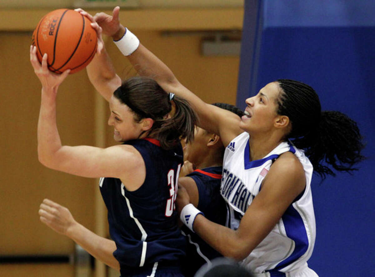 Seton Hall's Alexandra Maseko, right, tries to steal the ball from Connecticut's Kelly Faris (34) during the first half of an NCAA college basketball game in South Orange, N.J., Friday, Dec. 9, 2011. (AP Photo/Mel Evans)