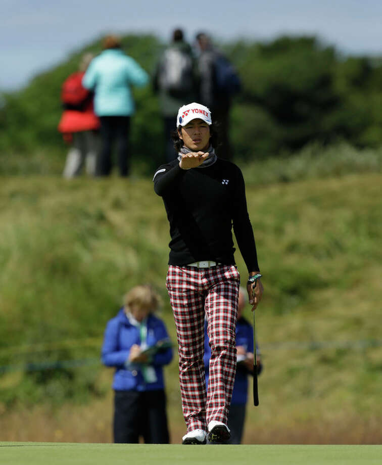 Ryo Ishikawa of Japan reacts after putting on the sixth green during a practice round at Royal Lytham & St Annes golf club ahead of the British Open Golf Championship, Lytham St Annes, England, Wednesday, July 18, 2012. (AP Photo/Jon Super) / AP