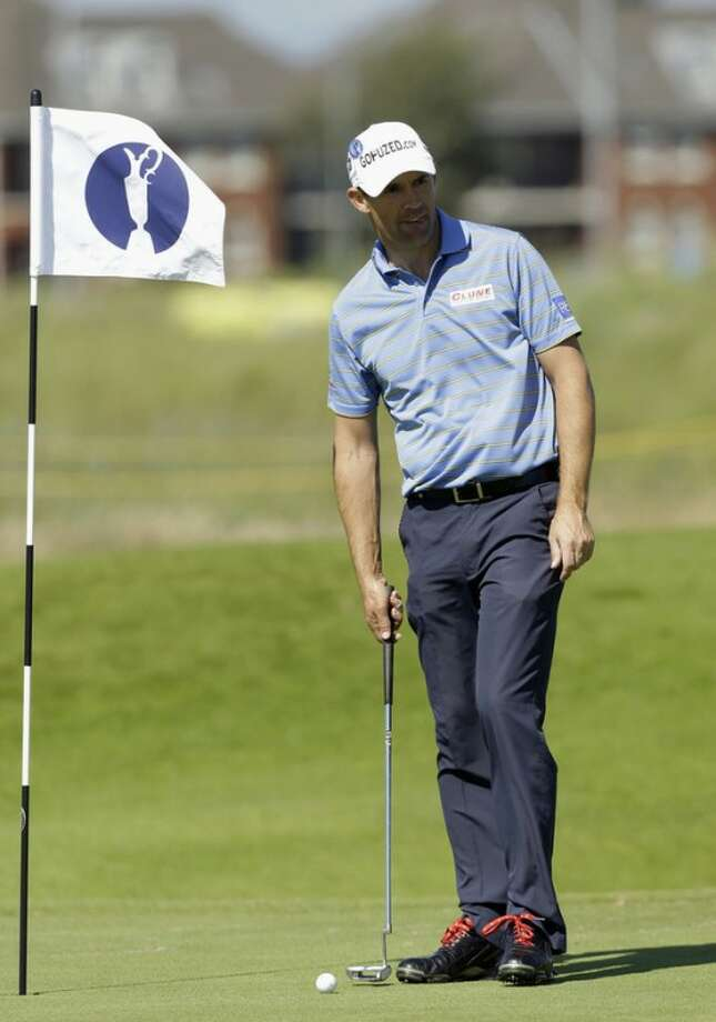 Padraig Harrington of Ireland prepares to play a putt on the 16th green during a practice round at Royal Lytham & St Annes golf club ahead of the British Open Golf Championship, Lytham St Annes, England, Wednesday, July 18, 2012. (AP Photo/Jon Super)