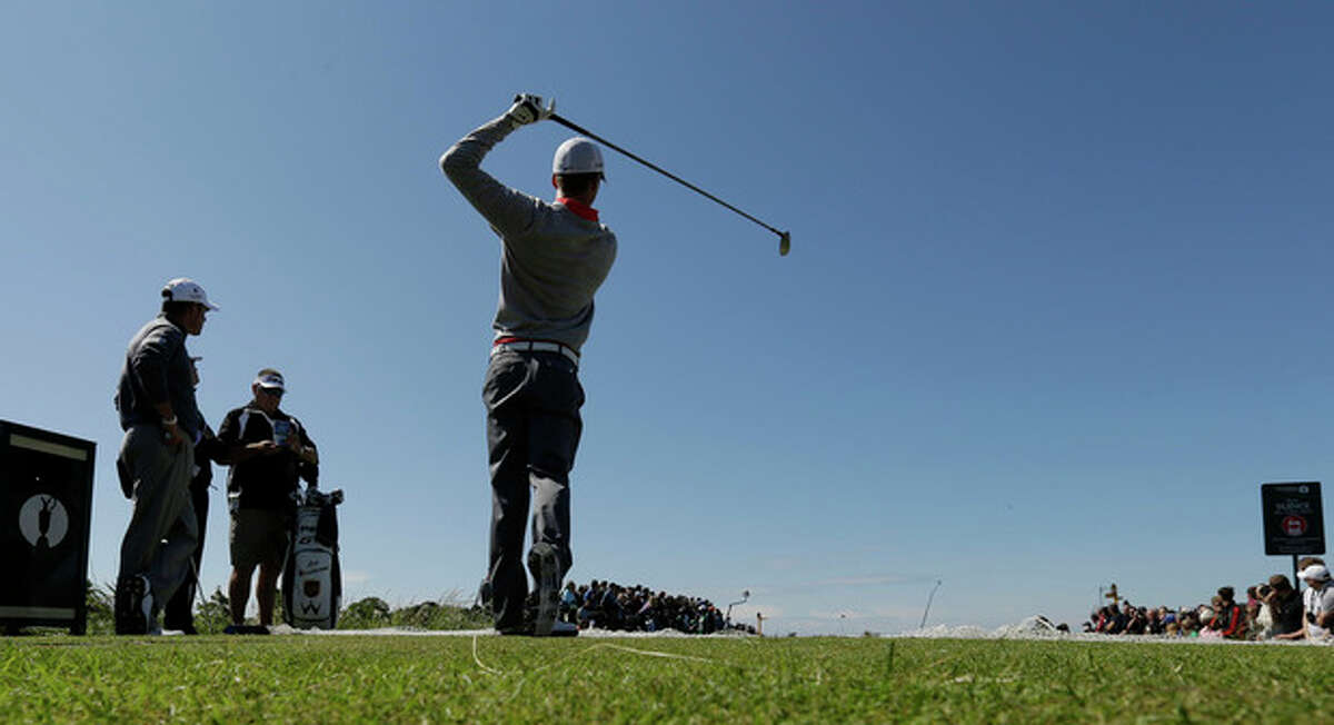 Branden Grace of South Africa plays a shot from the 11th tee during a practice round at Royal Lytham & St Annes golf club ahead of the British Open Golf Championship, Lytham St Annes, England, Wednesday, July 18, 2012. (AP Photo/Jon Super)