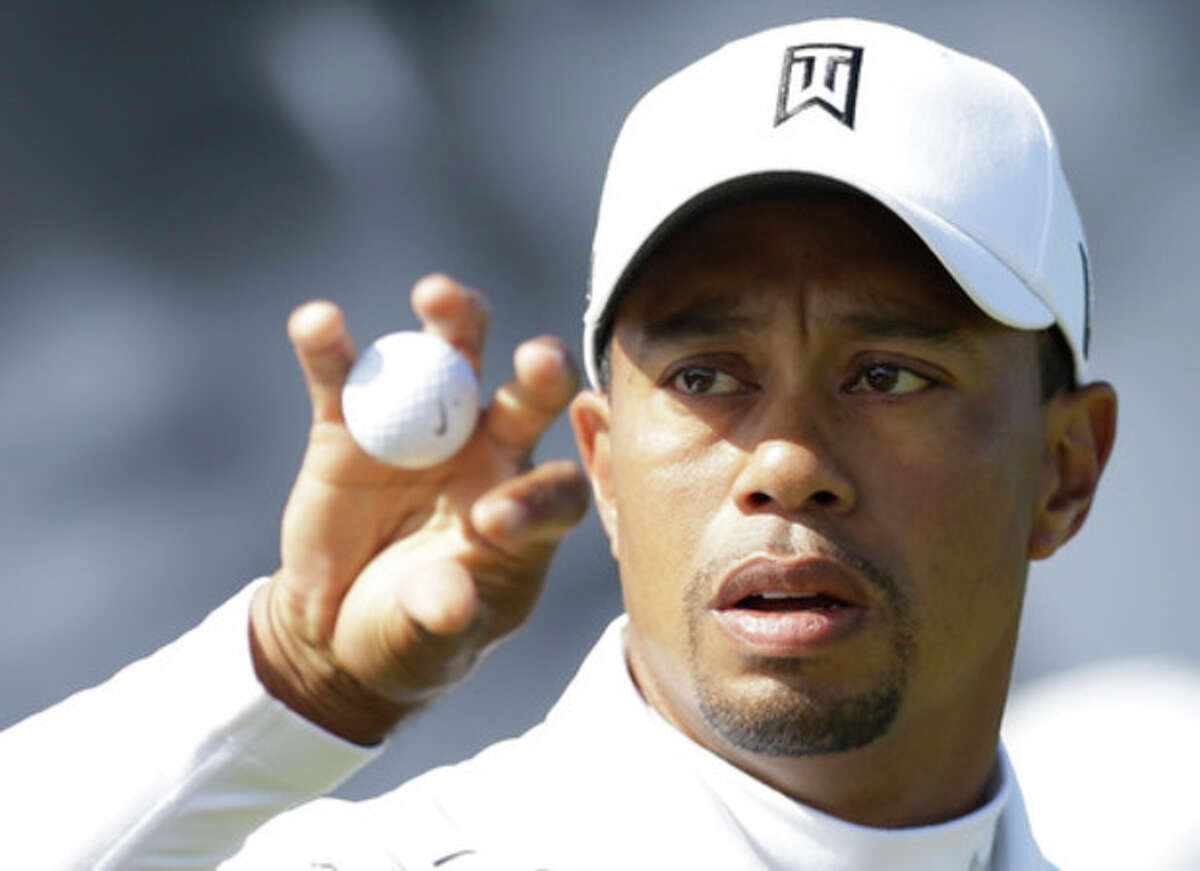 Tiger Woods of the United States holds a ball during a practice round at Royal Lytham & St Annes golf club ahead of the British Open Golf Championship, Lytham St Annes, England, Wednesday, July 18, 2012. (AP Photo/Jon Super)