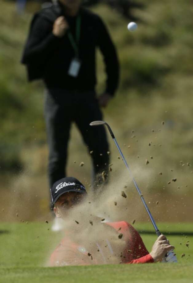 Morten Orum Madsen of Denmark plays out of a bunker during a practice round at Royal Lytham & St Annes golf club ahead of the British Open Golf Championship, Lytham St Annes, England, Wednesday, July 18, 2012. (AP Photo/Jon Super)