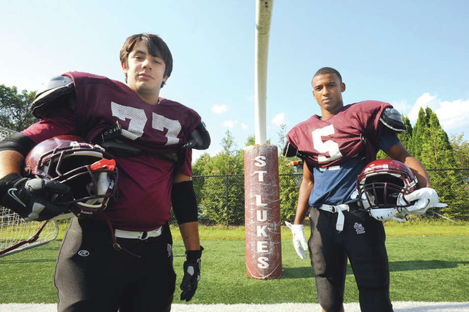 St. Luke's Joe Bonaddio and Noel Thomas. hour photo/Matthew Vinci / (C)2011, The Hour Newspapers, all rights reserved