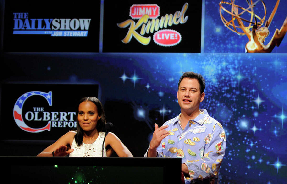 """Photo by Chris Pizzello/Invision/AP Comedian Jimmy Kimmel, right, reacts alongside fellow presenter Kerry Washington after """"Jimmy Kimmel Live""""; was nominated for Outstanding Variety Series during the nominations for the 64th Primetime Emmy Awards."""