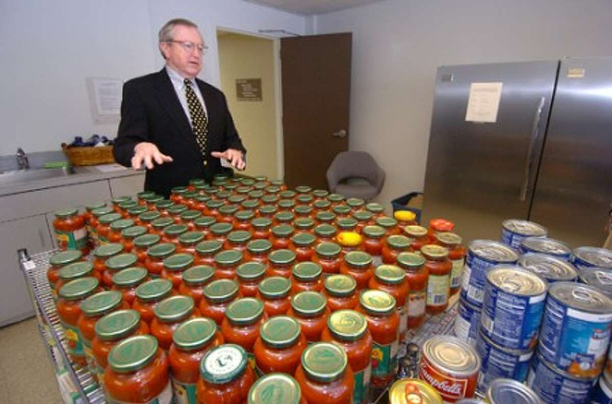 Photo/Alex von Kleydorff. Bill Brennan in the Comstock Community Centers food panrty maintained by Social services