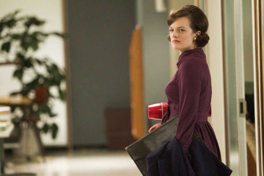 "In this publicity photo released by AMC, Elisabeth Moss as Peggy Olson is shown in Episode 11, Season 5, of ""Mad Men."" Moss was nominated for an Emmy award on Thursday, July 19, 2012 for outstanding actress in a drama series for her role as Peggy Olson. The 64th annual Primetime Emmy Awards will be presented Sept. 23 at the Nokia Theatre in Los Angeles, hosted by Jimmy Kimmel and airing live on ABC. (AP Photo/AMC, Jordin Althaus) / AMC"