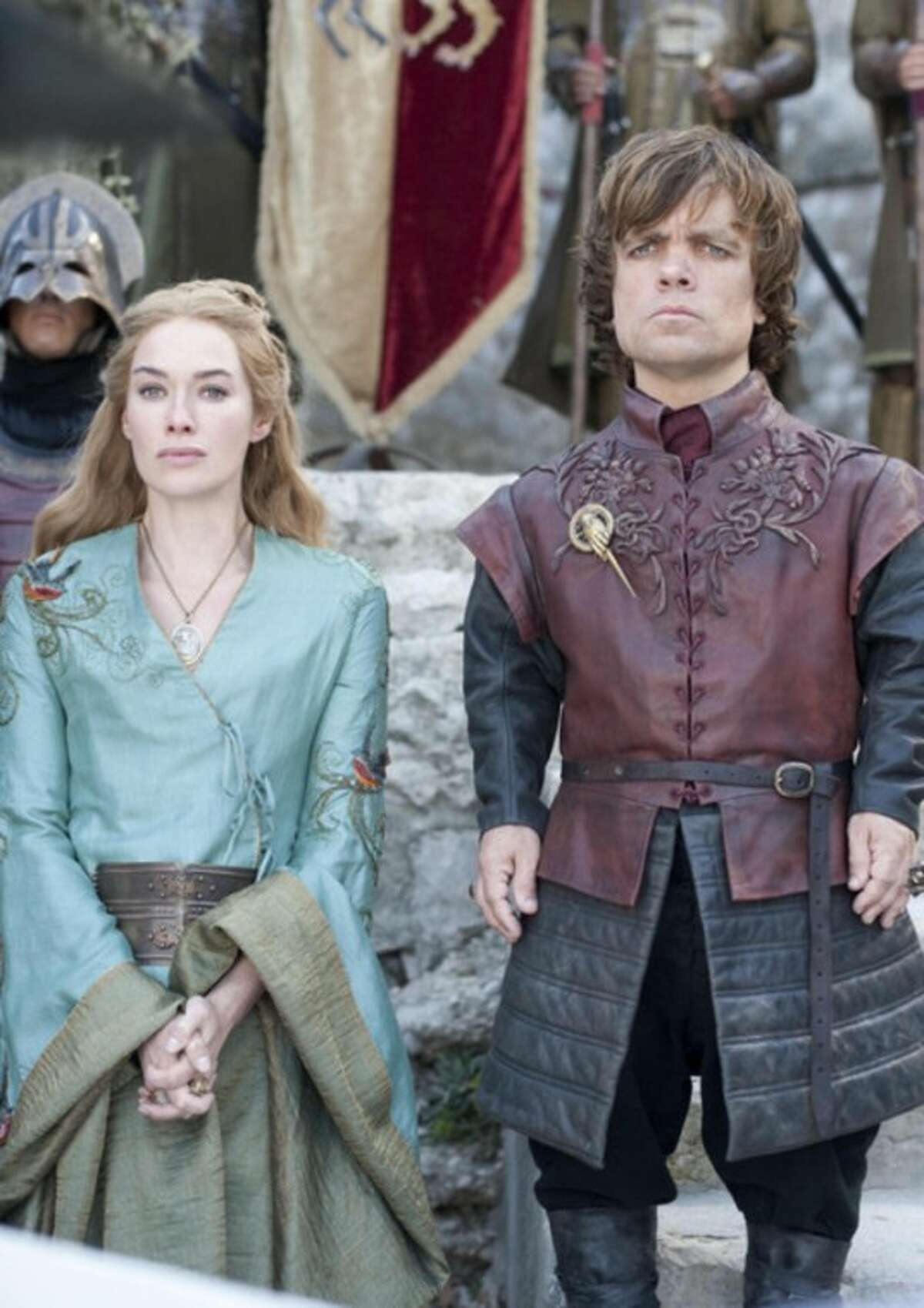 """FILE - In this publicity file photo provided by HBO, Lena Headey as Cersei Lannister, left, and Peter Dinklage as Tyrion Lannister, are shown in a scene from HBO's """"Game of Thrones."""" The program was nominated for an Emmy award for outstanding drama series on Thursday, July 19, 2012. The 64th annual Primetime Emmy Awards will be presented Sept. 23 at the Nokia Theatre in Los Angeles, hosted by Jimmy Kimmel and airing live on ABC. (AP Photo/HBO, Paul Schiraldi, File)"""