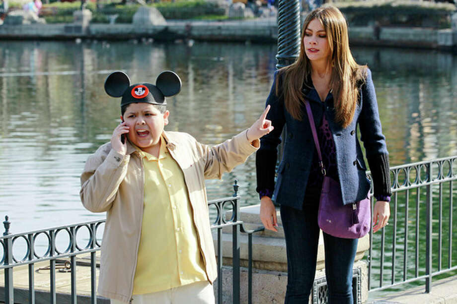"In this publicity photo released by ABC, Rico Rodriguez, left, and Sofia Vergara are shown in a scene from ""Modern Family."" The program was nominated for an Emmy award for outstanding comedy series on Thursday, July 19, 2012. The 64th annual Primetime Emmy Awards will be presented Sept. 23 at the Nokia Theatre in Los Angeles, hosted by Jimmy Kimmel and airing live on ABC. (AP Photo/ABC, Peter ""Hopper"" Stone) / ABC"