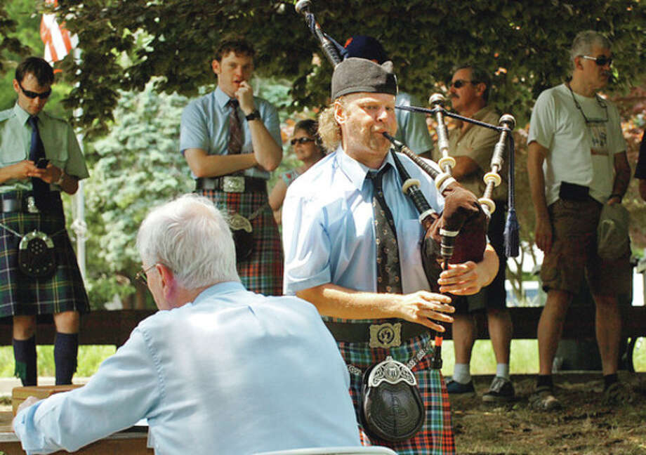 Matt Welch with the NY Metro Pipe Band is judged in the bagpipe competition during the Round Hill Highland Games at Cranbury Park Saturday.Hour photo / Erik Trautmann / (C)2012, The Hour Newspapers, all rights reserved