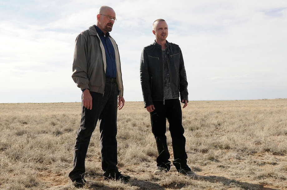 "This image released by AMC shows Bryan Cranston as Walter White, left, and Aaron Paul as Jesse Pinkman in a scene from the season 5 premiere of ""Breaking Bad."" The program was nominated for an Emmy award for outstanding drama series on Thursday, July 19, 2012. The 64th annual Primetime Emmy Awards will be presented Sept. 23 at the Nokia Theatre in Los Angeles, hosted by Jimmy Kimmel and airing live on ABC. (AP Photo/AMC, Ursula Coyote) / AMC"