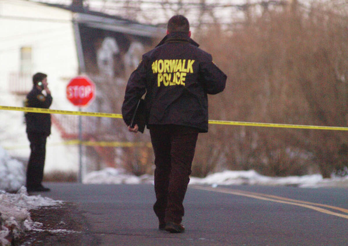 Norwalk Police respond to a suspected shooting on Lowe street in Norwalk at around 5:30 on Wednesday. hour photo/matthew vinci