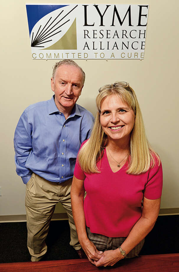 Lyme Research Alliance Executive Director Peter Wild and volunteer Janet Vaccaro, who is helping LRA get the word out about Lyme disease. / ©2012 The Hour Newspapers