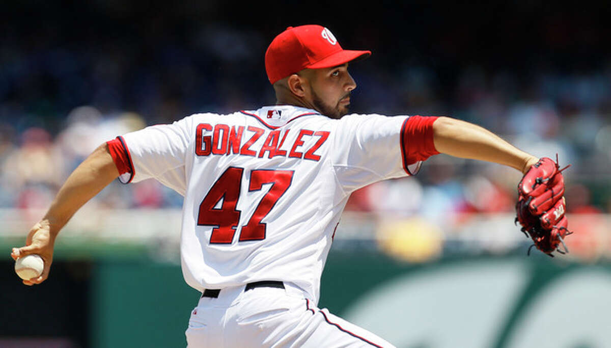 Washington Nationals starting pitcher Gio Gonzalez delivers in the second inning of a baseball game against the New York Mets at Nationals Park on Thursday, July 19, 2012, in Washington. (AP Photo/Carolyn Kaster)
