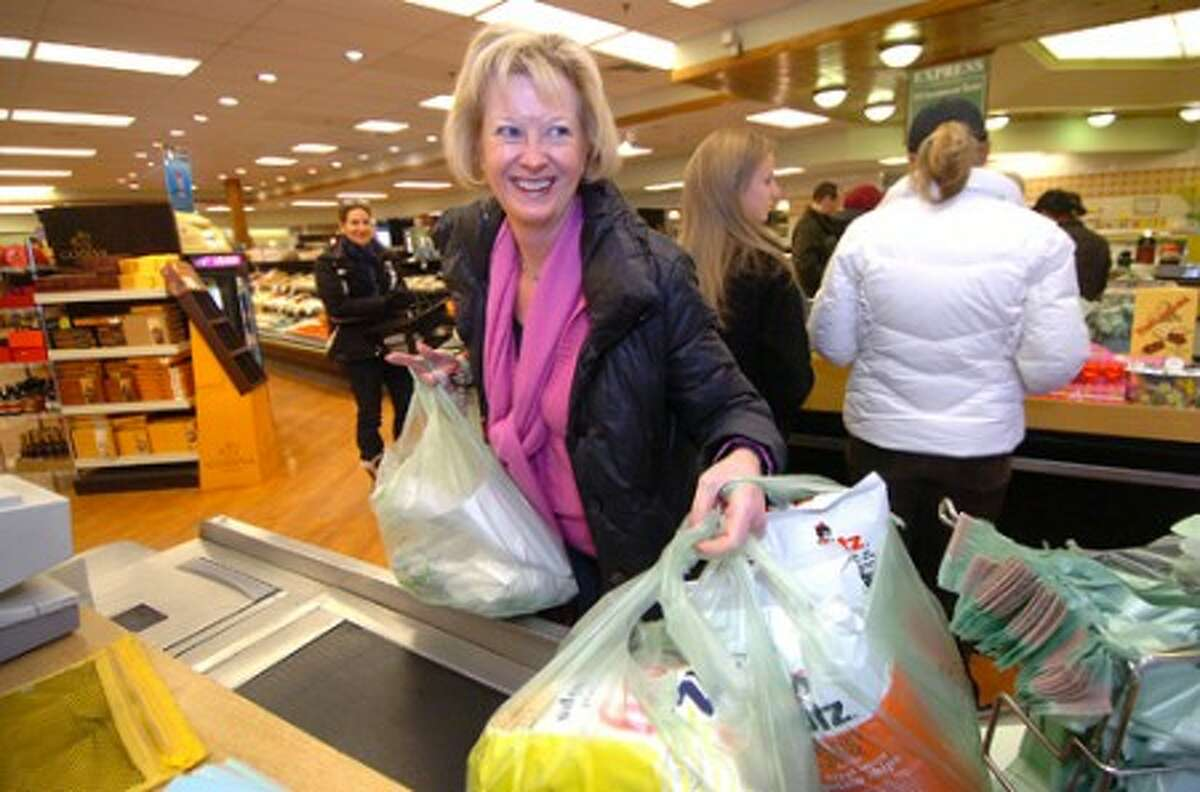 Photo/Alex von Kleydorff. Nancy Dolnier, Vice President at The Village Market grabs a big lunch order she will bring over to The Wilton bank. Business is steady at the market this winter season.
