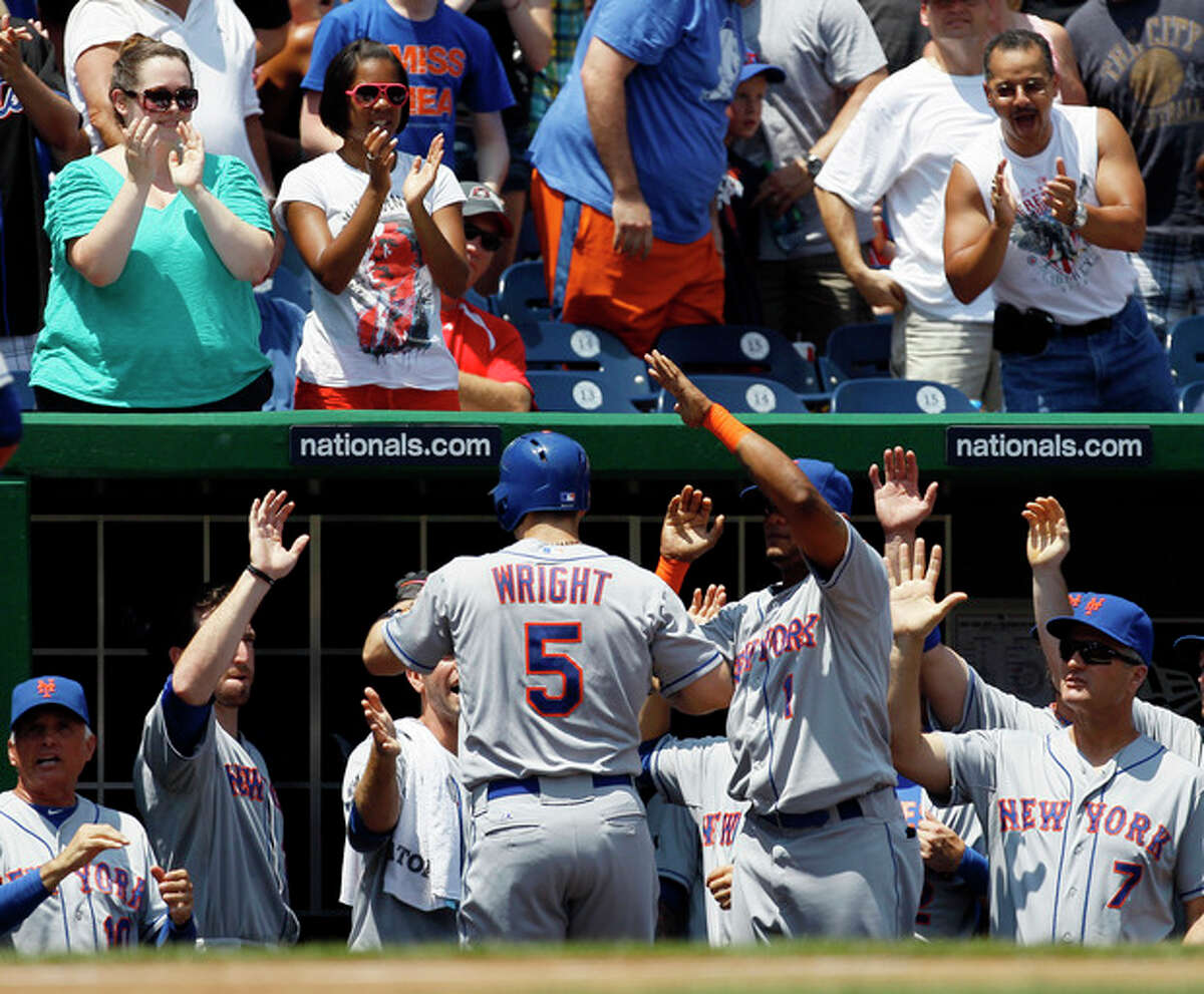 New York Mets' David Wright (5) is greeted by teammates after hitting a two-run home run in the first inning of a baseball game against the Washington Nationals at Nationals Park, Thursday, July 19, 2012, in Washington. (AP Photo/Carolyn Kaster)