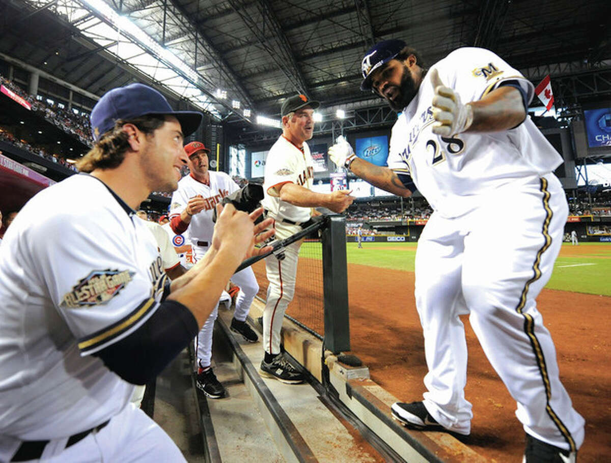 AP photo Prince Fielder of the Milwaukee Brewers is congratulated by National League manager Bruce Bochy of the San Francisco Giants and Milwaukee teammate Ryan Braun after hitting a three-run home run during the fourth inning of Tuesday?•s MLB All-Star game in Phoenix. The National League won, 5-1.