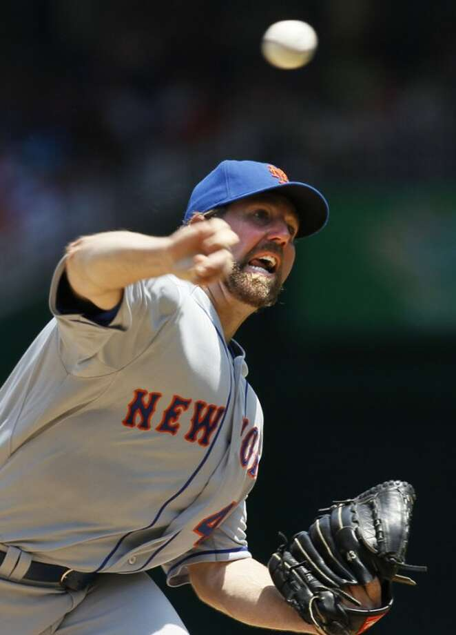 New York Mets starting pitcher R.A. Dickey pitches in the second inning of a baseball game against the Washington Nationals, Thursday, July 19, 2012, in Washington. (AP Photo/Carolyn Kaster)