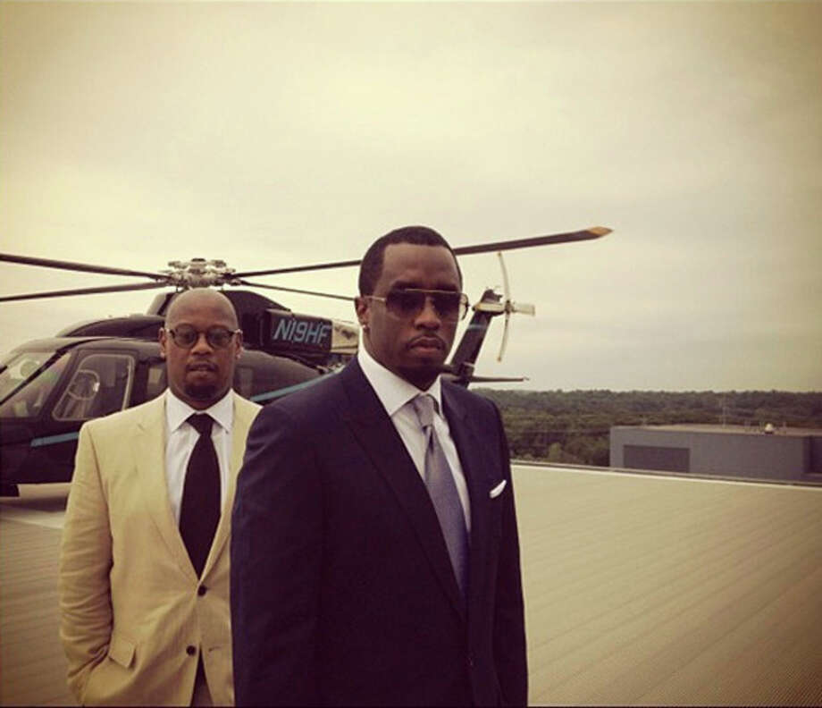 "Contributed photoSean ""P. Diddy"" Combs poses with Andre Harrell on the roof of Norwalk's Diageo building."