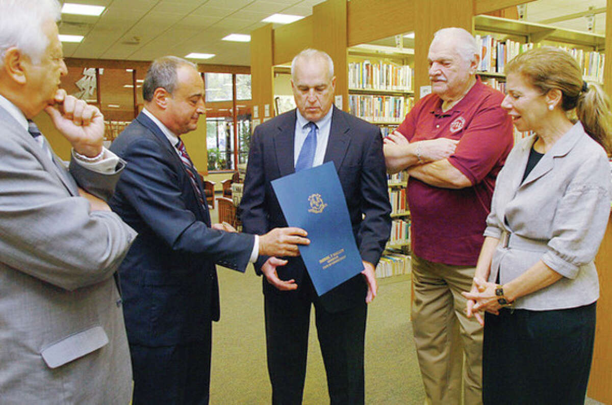 Jeffry Spahr, CACLD President, is presented a proclamation by the governor by State Representative and House Minority Leader Larry Cafero while Norwalk Mayor Richard Moccia, left, Stanley M. Siegel, secretary of the Norwalk Public Library Board of Directors and Christine Bradley, Norwalk Public Library Directo,r look on Thursday during a press conference proclaiming Oct. 16 - 22 ADHD Awareness Week at the libray on Belden Ave. Hour photo / Erik TrautmannHour photo / Erik Trautmann