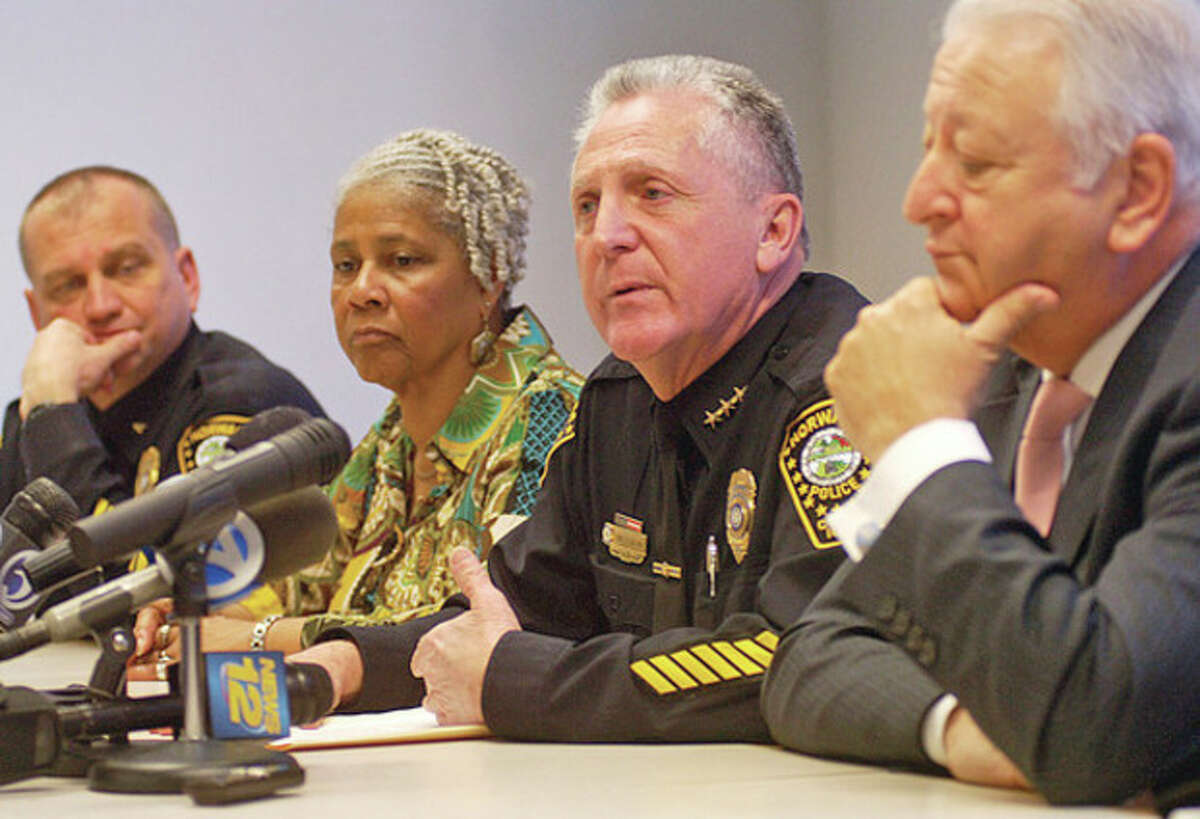 Norwalk Police Chief Harry Rilling speaks at a press conference relating to the shooting incident that occurred Tuesday night at Norwalk Hospital while Lt. Chief Thomas Kuhalwik, local NAACP chapter president, Anita Schmidt, and Norwalk Mayor Richard Moccia listen in Thursday at City Hall.