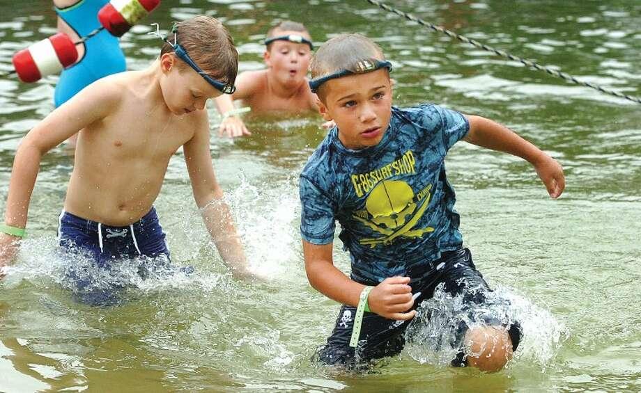 Hour Photo/ Alex von Kleydorff. Kids use the new Swimband at the Wilton family Y