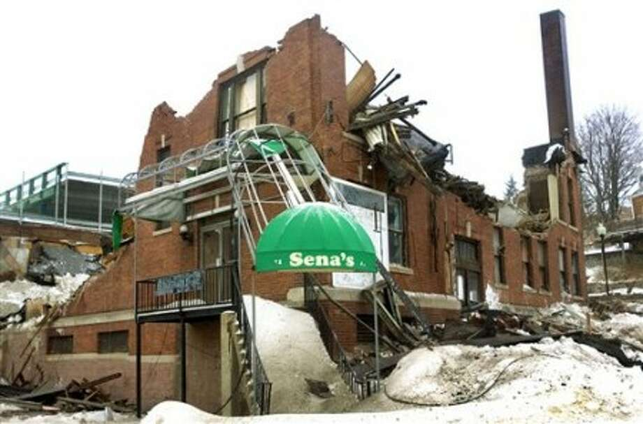 The old Sena''s Lanes building on North Main Street in Waterbury, Conn. is photographed on Wednesday, Feb. 2, 2011. The building collapsed under the weight of snow and ice Wednesday morning, Waterbury police said. No one was injured. (AP Photo/The Republican-American, Steven Valenti)