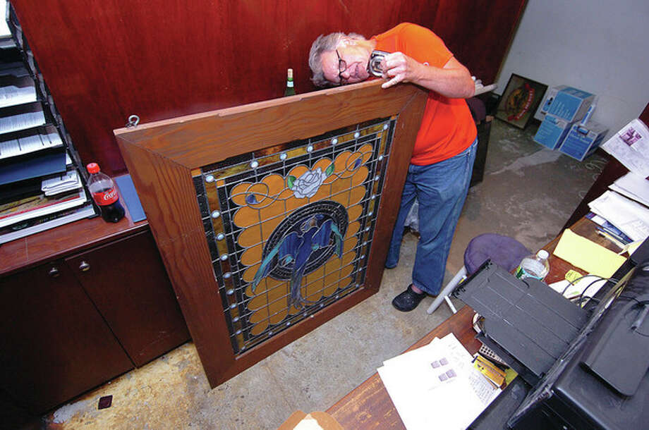 Hour photo / Alex von KleydorffLeaded Glass Mural Artist Will Turey measures the Stained Glass panel of a parrot for a display box at The Blu Parrot in Westport. / 2012 The Hour Newspapers