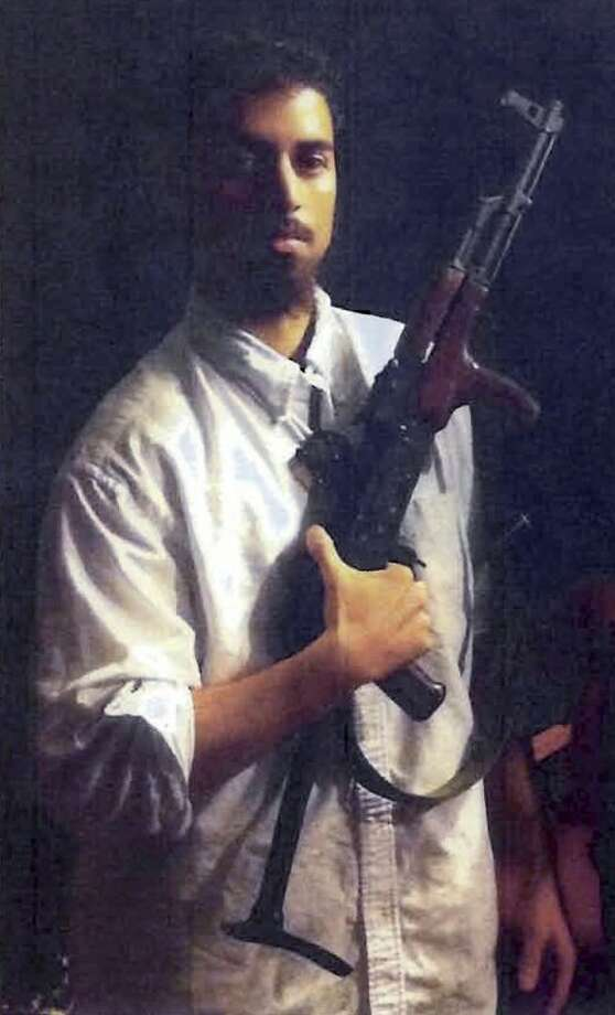 FILE - This section of an undated file photo released by the U.S. Attorney's Office, which had been presented as a government exhibit at a 2011 hearing, shows Rezwan Ferdaus, of Ashland, Mass. Ferdaus is scheduled to plead guilty Friday, July 20, 2012 in Boston federal court to attempting to provide material support to terrorists and attempting to damage and destroy federal buildings by means of an explosive. (AP Photo/U.S. Attorney's Office, File)