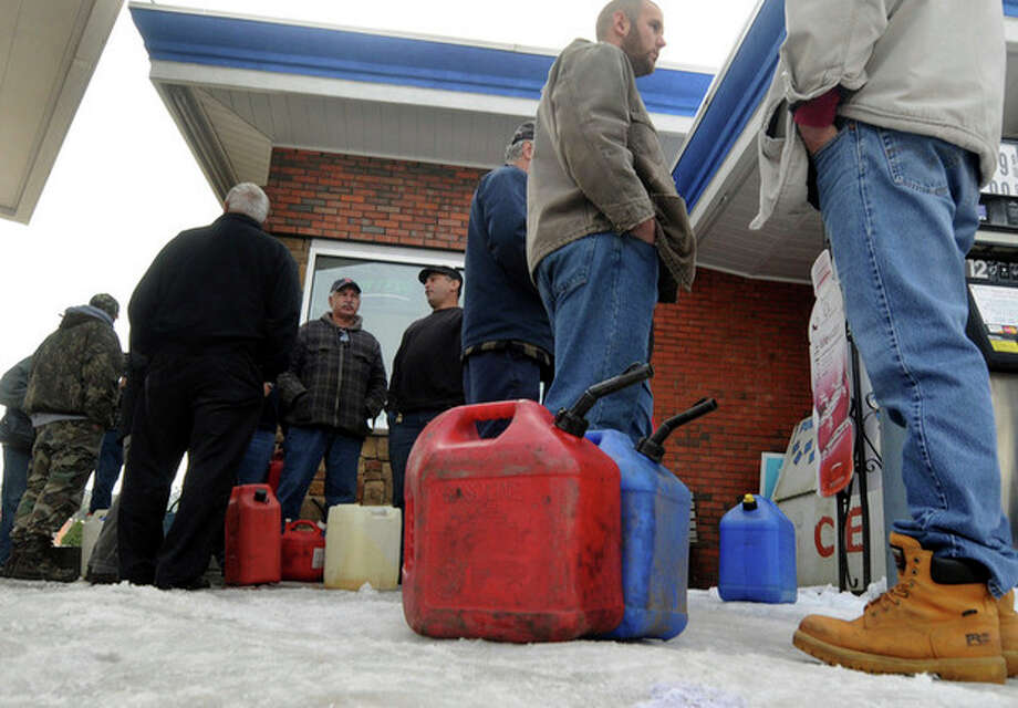 A long line of customers wait to buy Kerosene in Vernon, Conn., Monday, Oct. 31, 2011. The unseasonably early nor'easter over the weekend has utility companies struggling to restore electricity to more than 3 million homes and businesses. (AP Photo/Journal Inquirer, Jim Michaudl) / Journal Inquirer